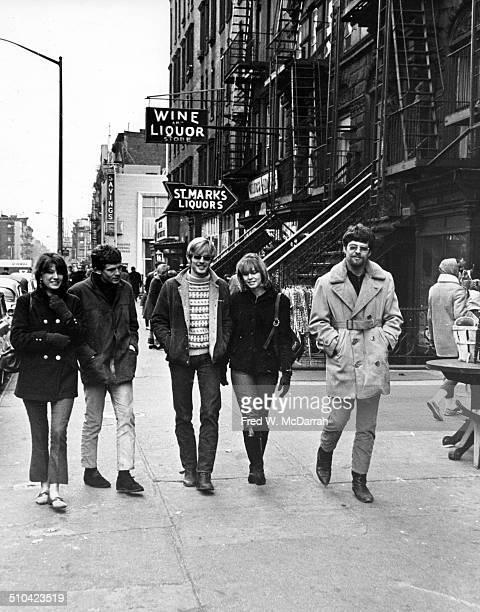 A group of people walk together along St Marks Place New York New York January 16 1966 They are on the south side of St Marks