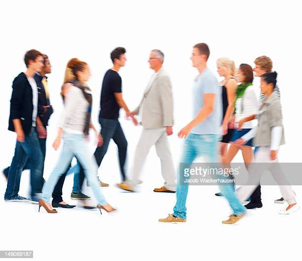 Group of people walking against white background
