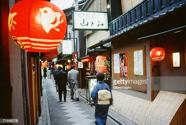 Group of people walking on a street, Pontocho Geisha District, Kyoto, Japan