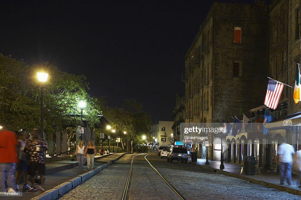 Group of people walking on the walkway at night, Savannah, Georgia, USA : Stock Photo