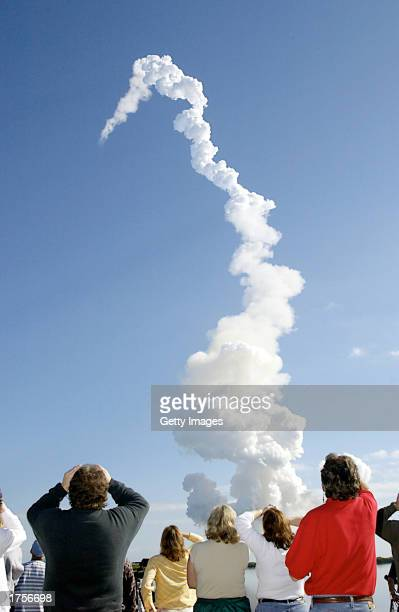 A group of people watch as the Space Shuttle Columbia lifts off on January 16 2003 at Cape Canaveral Florida NASA Mission Control lost contact with...