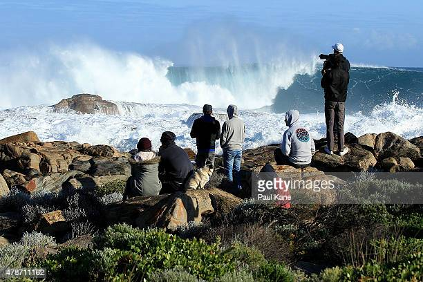 A group of people watch large waves at Cowaramup Bay on June 27 2015 in Margaret River Australia Monster swells were predicted for the south west...