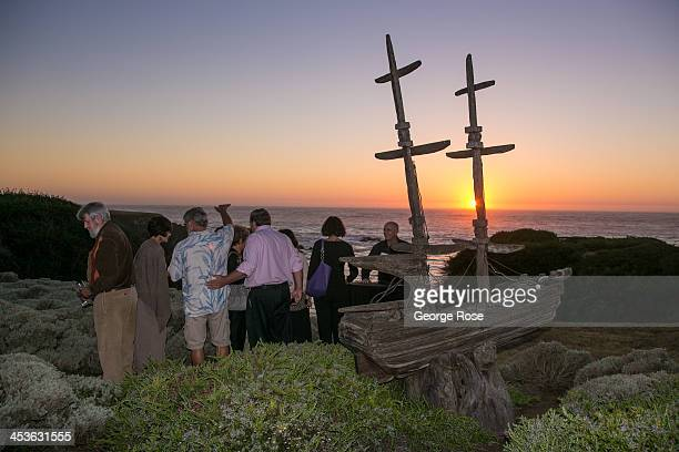 A group of people watch the sun set over the Pacific Ocean near the Mendocino Coast Botanical Gardens on September 6 in Fort Bragg California Located...