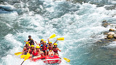 Group of people white water rafting. The raft goes through a big rapid on Koprulu Canyon near Antalya, Turke