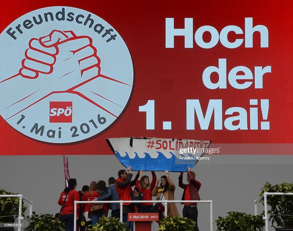 Group of people, who criticize refugee policy of the government, unfurl a symbolic ship banner saying 'Solidarity' during a rally to mark May Day, International Workers' Day, in front of municipal building in Vienna, capital city of Austria on May 1, 2016.