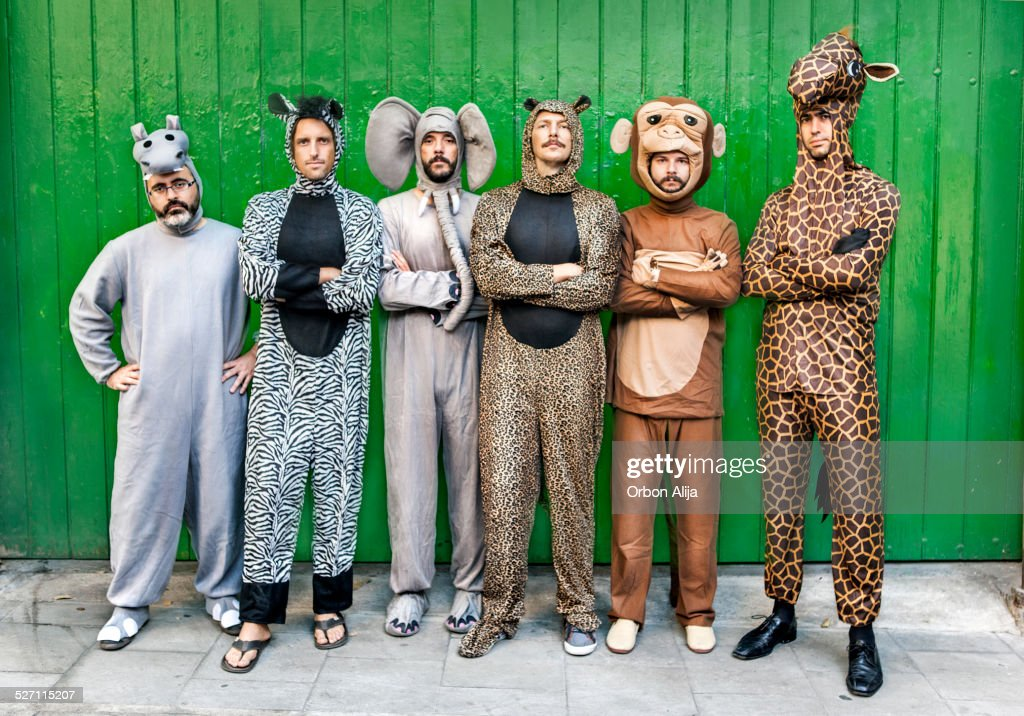 Group of people with animal costumes : Stock Photo