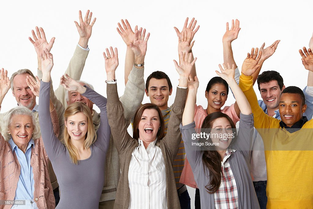 Group of people with arms raised