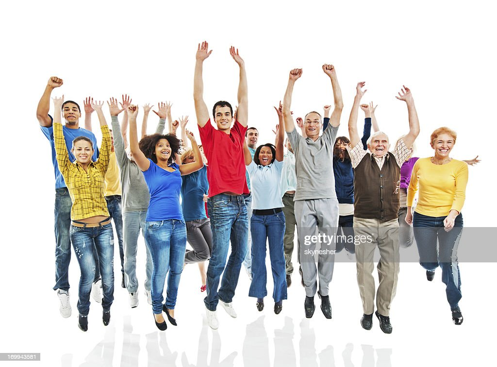 Group of people with raised hands jumping. : Stock Photo