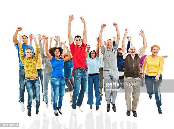 Group of people with raised hands jumping.