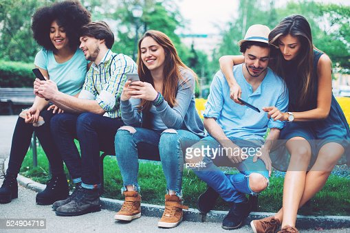 Group of people with smart phones