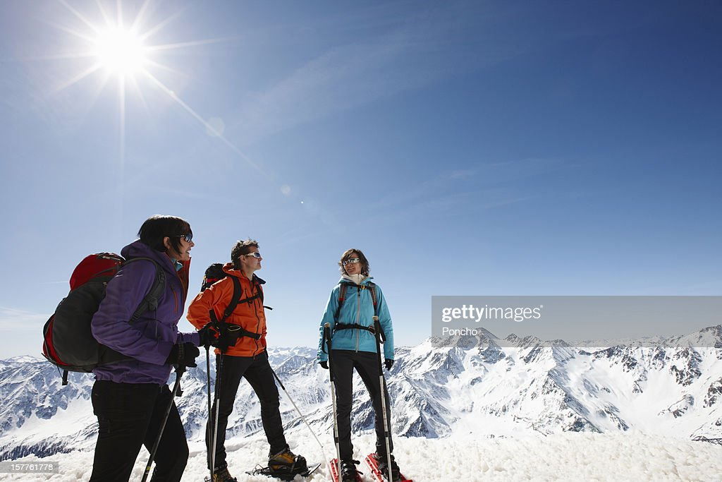 Group of people with snowshoes at Mountain Top : Stock Photo