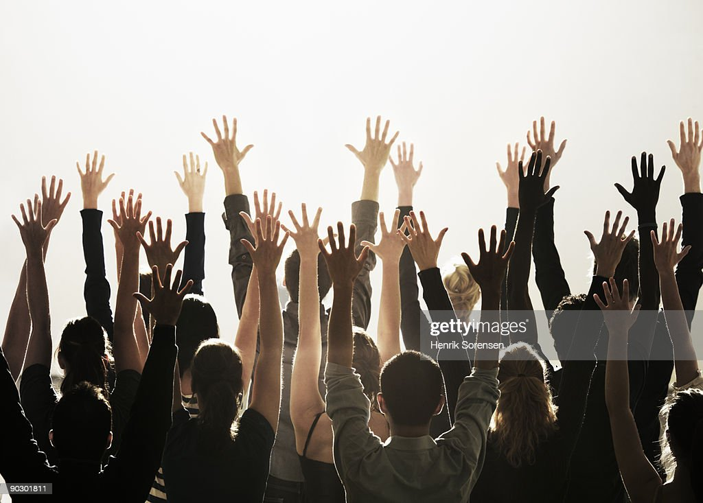 group of people with their hands raised : Stock Photo