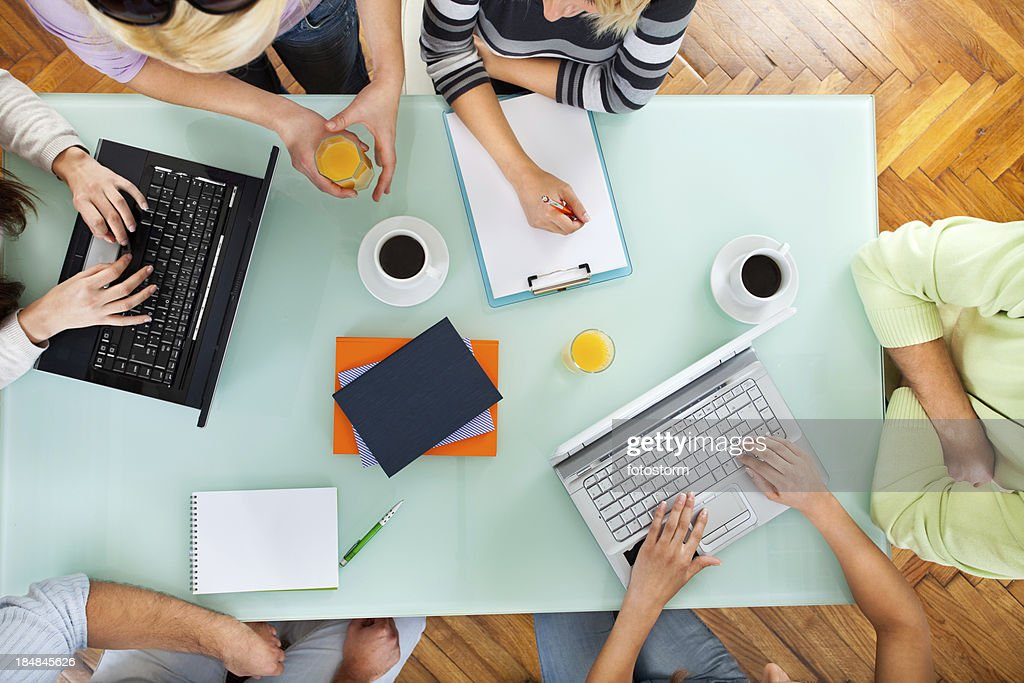 Group of people with two laptops at a meeting : Stock Photo