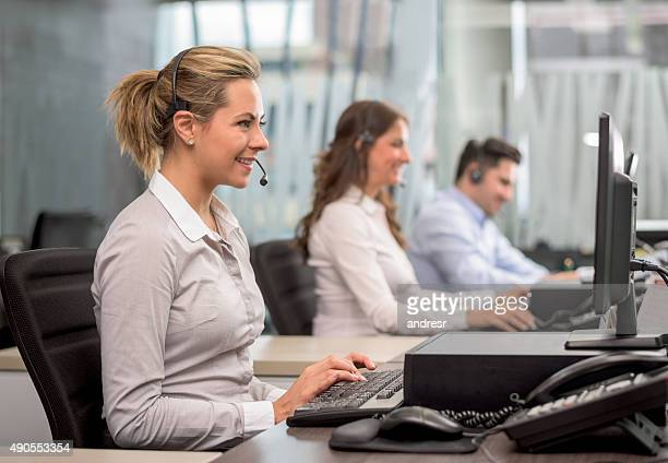 Group of people working at a call center