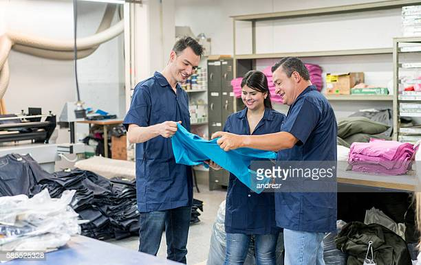 Group of people working at a clothing factory