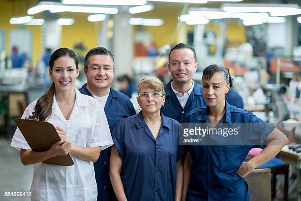Group of people working at a factory