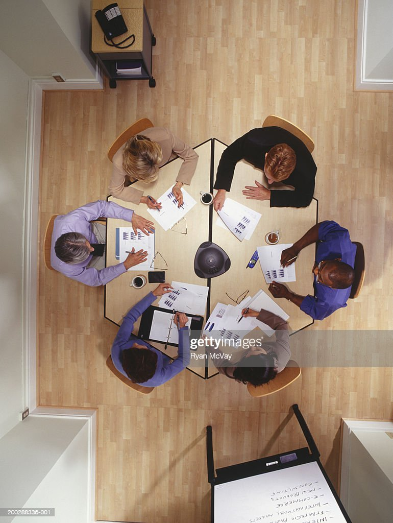 Group of people working at table in office, overhead view : Stock Photo