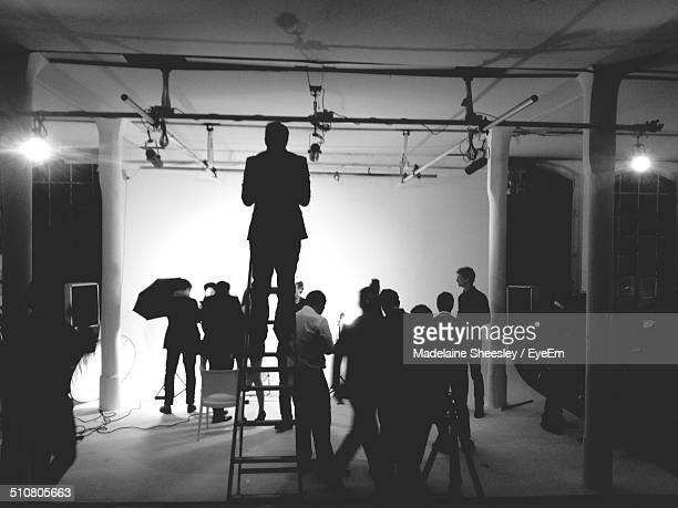 Group of people working in photo studio
