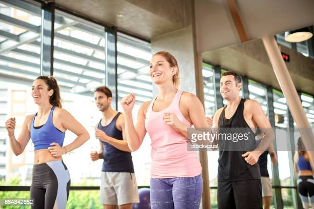 Group of people working out in a class in a gym