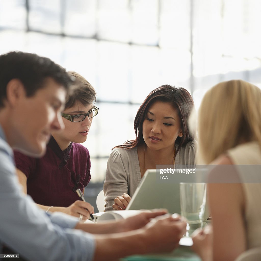 Group Of People Working Together During Meeting : Stock Photo