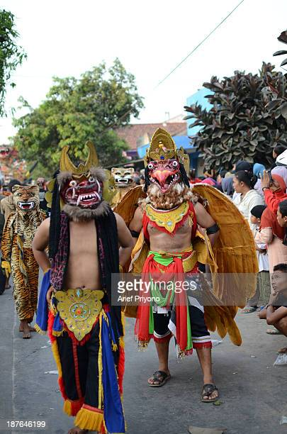 A group of performers in a traditional art performance known as 'Bantengan' in Trowulan village Bantengan is a traditional Indonesian dance which...