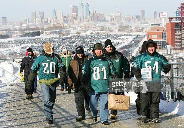 A group of Philadelphia Eagles fans enter the stadium with the downtown Philadelphia skyline in the background before the start of the NFC...