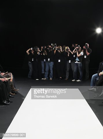 Group of photographers in front of catwalk at fashion show : Stock Photo