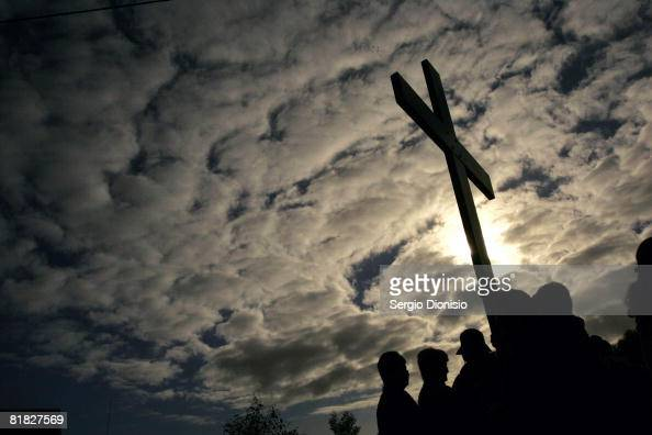 A group of pilgrims pray around a Crucifix while taking part in the Journey of the Cross and Icon as part of the build up to World Youth Day Sydney...