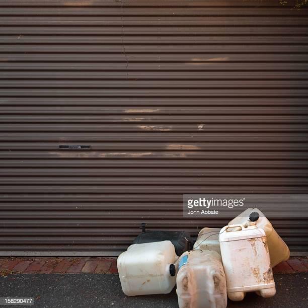 Group of plastic drums and garage door