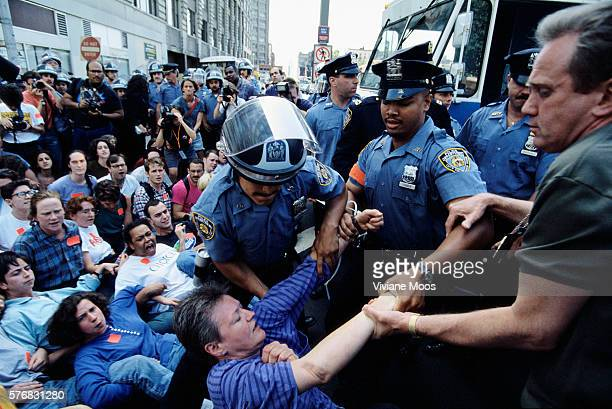 A group of police officers pull a middleaged woman off the street where she is demonstrating with a crowd of prochoice abortion rights activists The...
