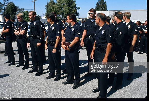A group of police officers stand June 10 1988 in Los Angeles CA The Los Angeles Police Department swept through gangridden neighborhoods in an effort...