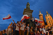 A group of Polish pilgrims singing at Adam Mickiewicz monument as only a few pilgrims attended Tuesday evening concert in Krakow's Main Square due to...
