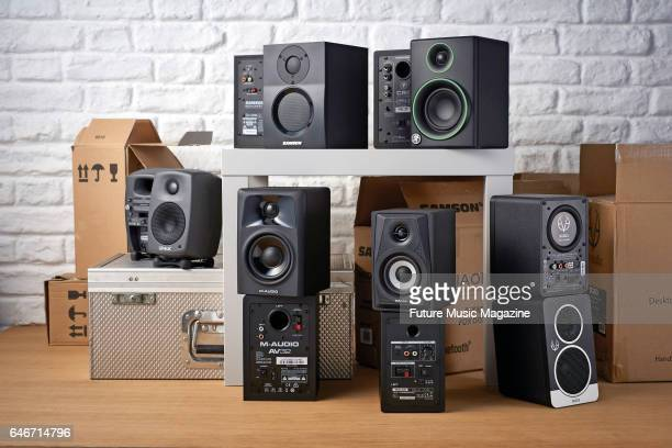 A group of powered monitors including Samson MediaOne BT3 Mackie Creative Reference CR3 Eve Audio SC203 Tascam VLS3 MAudio AV32 and Genelec 8010A on...