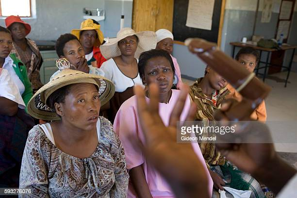 A group of pregnant women listen attentively to a condom demonstration during a antenatal session in Thabana Morena clinic The group is given advice...
