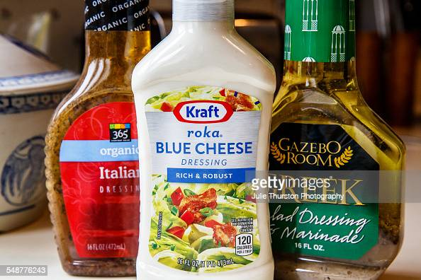 Group of prepared bottled salad dressings Kraft Roka Blue Cheese 365 Italian dressing and Gazebo Room Greek dressing and marinade all with colorful...
