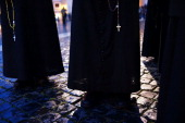 A group of priests wait for a sign of smoke in St Peter's Square on March 12 2013 in Vatican City Vatican Pope Benedict XVI's successor is being...