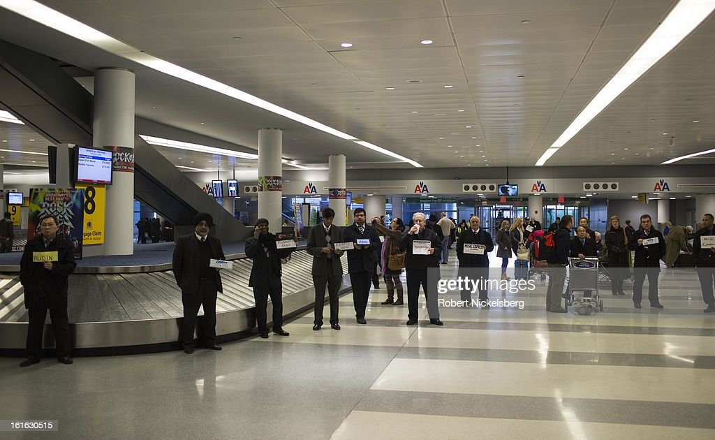 A group of private limousine drivers wait for arriving passengers February 3, 2013 at the John F Kennedy International Airport in the Queens borough of New York.