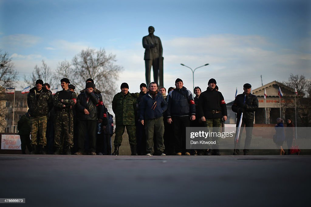 A group of Pro Russian volunteers making up a 'Self Defence Force' make a formation in Lenin Square on March 13, 2014 in Simferopol, Ukraine. As the standoff between the Russian military and Ukrainian forces continues in Ukraine's Crimean peninsula, world leaders are pushing for a diplomatic solution to the escalating situation. Crimean citizens will vote in a referendum on 16 March on whether to become part of the Russian federation.