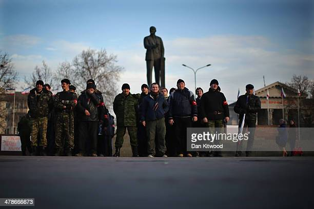 A group of Pro Russian volunteers making up a 'Self Defence Force' make a formation in Lenin Square on March 13 2014 in Simferopol Ukraine As the...