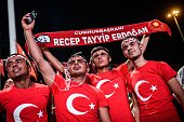 A group of proErdogan supporters look on during a rally in Taksim square in Istanbul on July 22 following the failed military coup attempt of July 15...