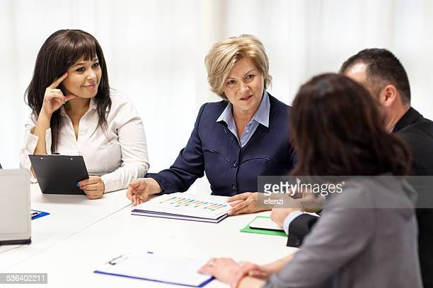 Group Of Professionals At Business Meeting