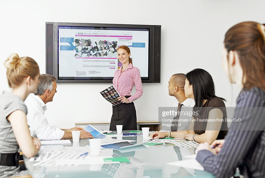 A group of professionals in a meeting : Stock Photo