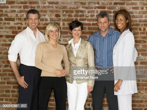 Group of professionals smiling, portrait : Stock Photo