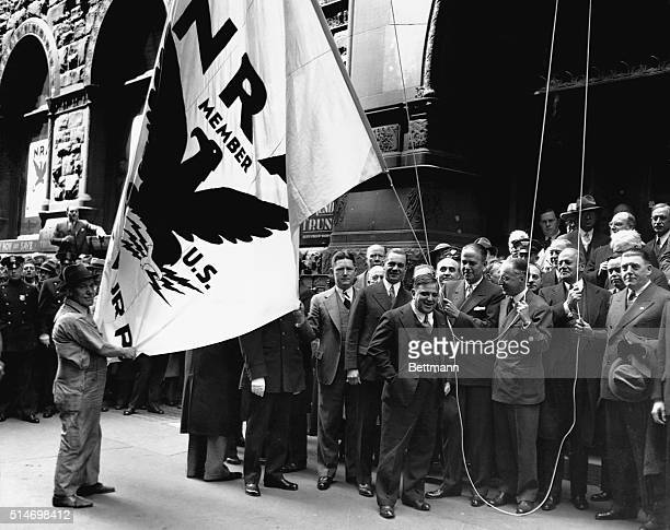 A group of prominent New Yorkers attend a dedication ceremony and flag raising at the new National Recovery Administration state headquarters in...