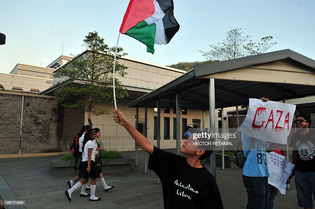 A group of pro-Palestinian demonstrators protest in front of the US embassy in Managua to demand an end to the Israeli attacks on the Gaza Strip, on November 19, 2012. More than 100 people have been killed in the Hamas-ruled Gaza Strip since Israel began a massive air campaign aimed at halting rocket fire from the Palestinian enclave last Wednesday. AFP PHOTO/Hector RETAMAL