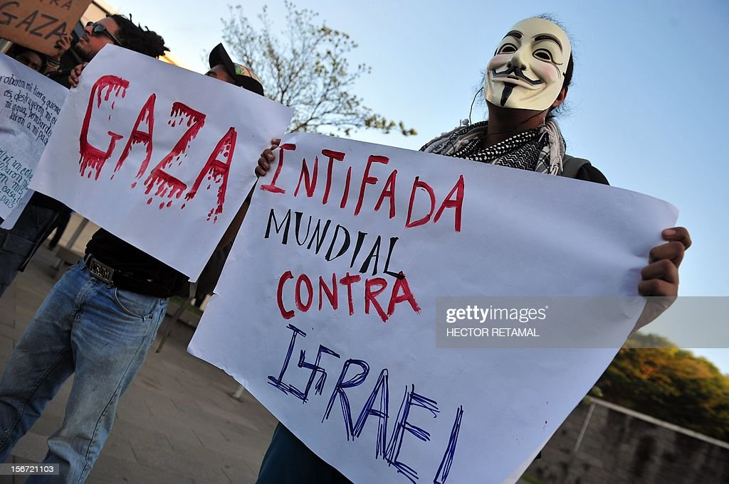 A group of pro-Palestinian demonstrators protest in front of the US embassy in Managua to demand an end to the Israeli attacks on the Gaza Strip, on November 19, 2012. More than 100 people have been killed in the Hamas-ruled Gaza Strip since Israel began a massive air campaign aimed at halting rocket fire from the Palestinian enclave last Wednesday. The placard reads 'World Intifada Against Israel'. AFP PHOTO/Hector RETAMAL