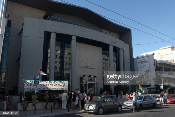 A group of proPalestinian people stage a demonstration to protest Israel outside a building in which Israeli Embassy organize a cultural event...