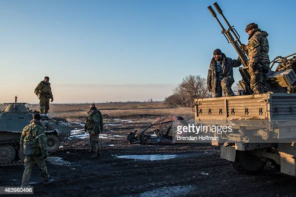 A group of proRussian Cossack rebel fighters organize equipment some of which was captured from the Ukrainian Army on February 20 2015 in Debaltseve...