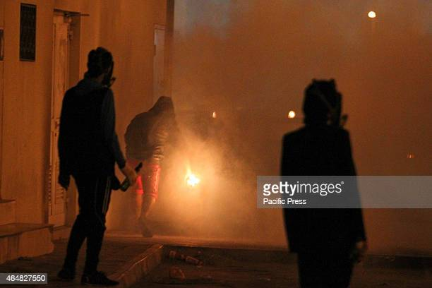A group of protesters carrying Molotov cocktails during clashes with Bahraini regime forces after the issuance of the death sentence against a group...