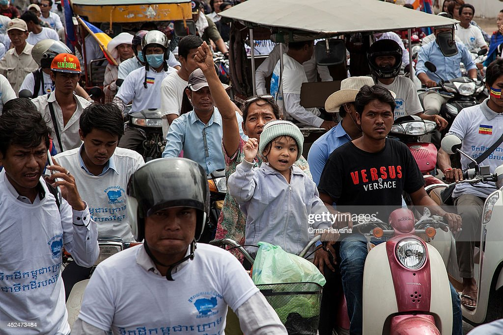 A group of protesters shout slogans during a demonstration though the city streets to demand the return of the Kampuchea Krom territories to Cambodia on July 21, 2014 in Phnom Penh, Cambodia. Thousands of protesters and monks march through the streets of Phnom Penh to deliver petitions to the French, British, American, Russian and Chinese embassies, before arriving at the Vietnamese Embassy. The protesters, organised by the Federation of Cambodian Intellectuals and Students (FCIS) and leaders of the Khmer Krom community, are demanding an apology from Vietnamese Embassy First Counsellor Tran Van Thong, who recently said that the former Kampuchea Krom provinces were held by Vietnam before their occupation by France. Ahead of the protest, Phnom Penh municipal authorities banned the protest, threatening the protesters who defied the ban could be jailed for up to 15 years.